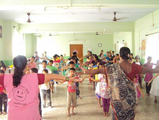 Summer camp children enjoying the yoga sessions at HOPE center.