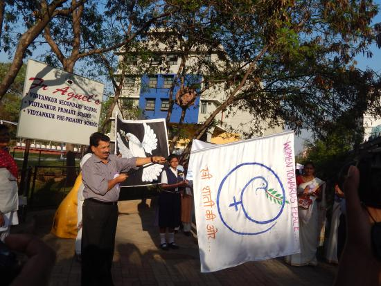 Flagging off the rally by Inspector Peter Lobo.
